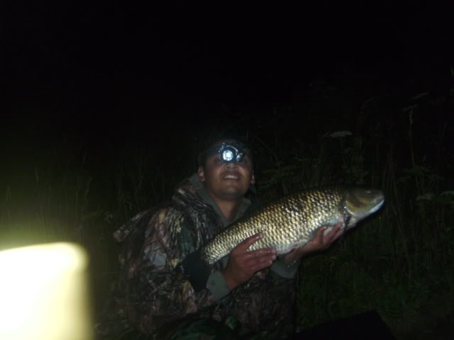 Ahmed with a broken headtorch and a 7lb 1oz chub.