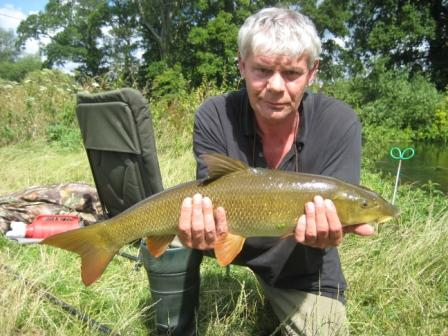 Alan Paget with a lovely looking barbel of around 7lbs