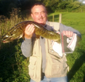 Barry with his boilie stealing 12lb pike