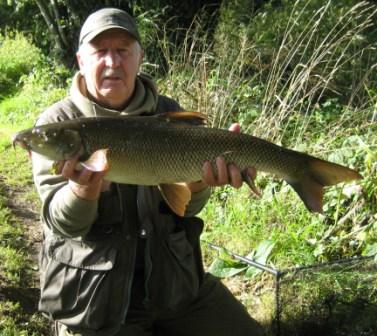 Author of these reports and all round great bloke Brian Willson with an 8lb 15oz barbel.