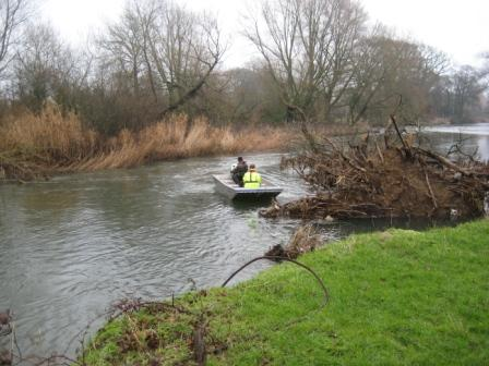 EA working to remove the tree from the water