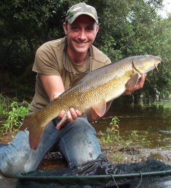 A cracking picture of a happy Eddy Widdup holding a 10lb 2oz beauty.
