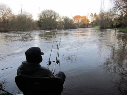Ian Reed fishing in the high water at Throop