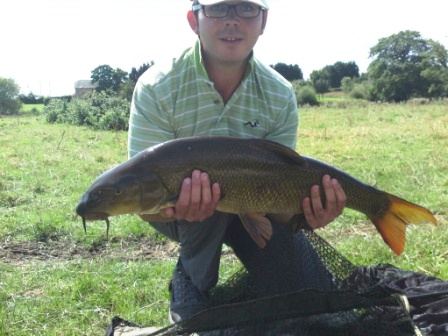 James Hill with his first  ever barbel weighing 12lb 4ozs