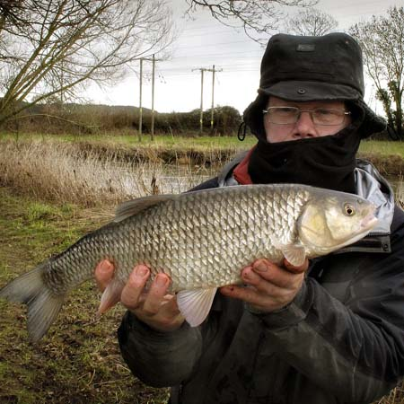 Kevin Smith with a nice 4lb 6oz chub taken on a freezing cold day