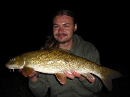Luke with a 7lb 1oz barbel taken at last knockings from a rarely fished area of Throop