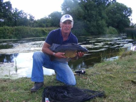 Mick Burbridge with a lovely 12lb 4oz river carp