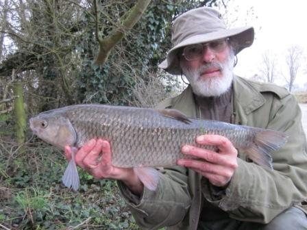 Neil Hurren with the larger of a brace of six pound chub, weighing 6lb 6oz