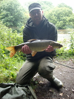 Phil with his first ever barbel weighing six pounds. Congratulations Phil!!