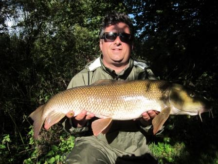 Rick  Willson and a cracking 12lb 3oz barbel