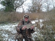 Roger Hill lands a 5lb 13oz chub in freezing conditions
