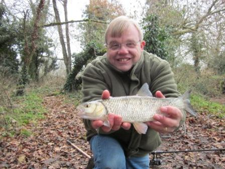 Simon Evans with a small chub which he landed as Brian was doing his rounds