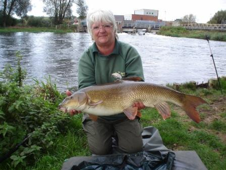 Birthday girl Tina with her PB barbel weighing 13lb 5oz (and caught from the Royalty Brian!)