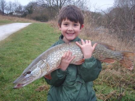 Joe New with his new PB pike weighing 12lb 4oz