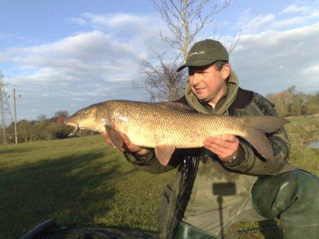 Paul Fuller shows off the best of his days catch, a 10lb 4oz barbel