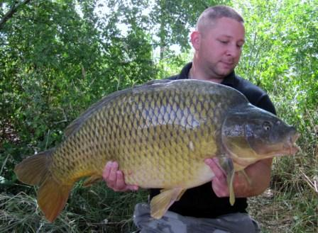 stuart with a stunning 43lb common carp