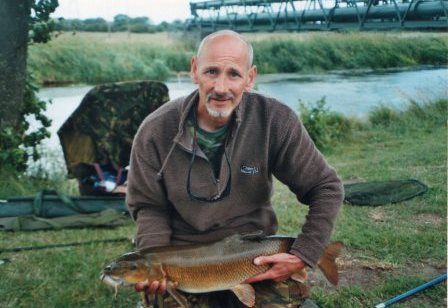 Adrian Mitchell and a cracking 12lb 8oz barbel from the Pipes