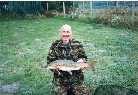 Adrian Mitchell and another barbel this time weighing 8lbs