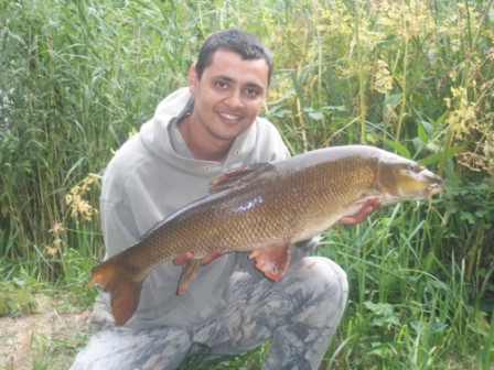 Ahmed Salem with the 13lb 1oz barbel that eluded Keith Arthur