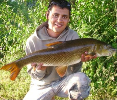 Ahmed Salem with a 9lb 15oz barbel which was left out of the previous report
