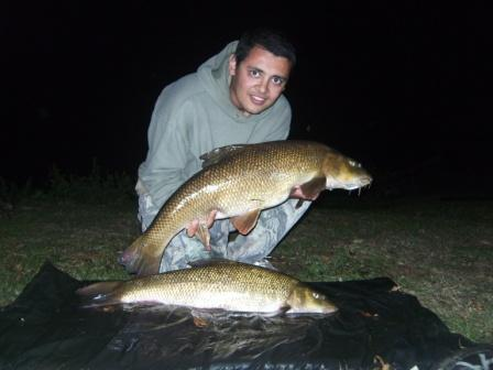 Ahmed Salem with a brace weighing 13lb 8oz and 7lb 14oz. Incredibly he was recovering the larger fish when he had a take on his second rod. The result is an extremely rare photo of a brace of Royalty barbel.