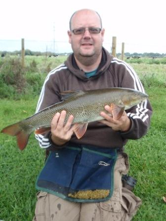 Allan Smallbones with another nice barbel from the Compound