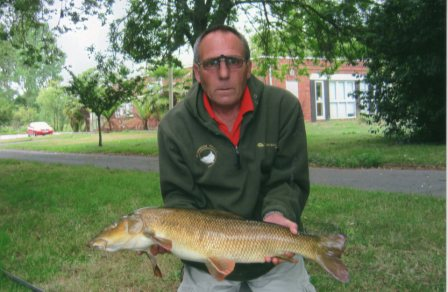Chris Allport took a day off from Throop to land this 12lb barbel from the Parlour