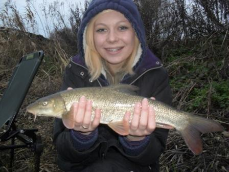 Christina with her first ever barbel weighing around the pound mark. She was being guided by cult Royalty angler Jeff Edisbury
