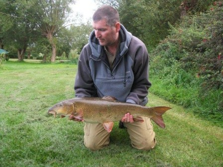 Darren Cartwright with a lovely 14lb barbel