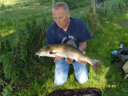 Jed with a little less hair than when he last landed an 11lb 8oz Royalty barbel.