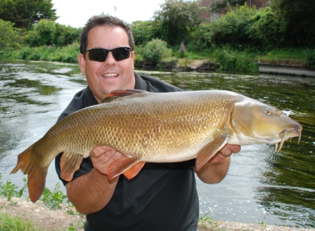Jez Brown with a Pallatrax sponsored 13lb 9oz barbel from the Parlour