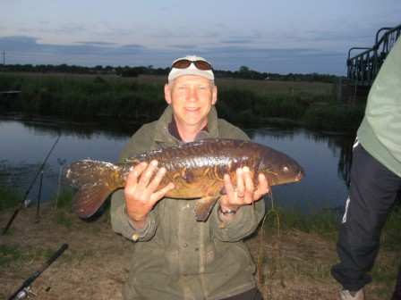 Kevin Attwood with a bonus 11lb mirror carp from above the Pipes