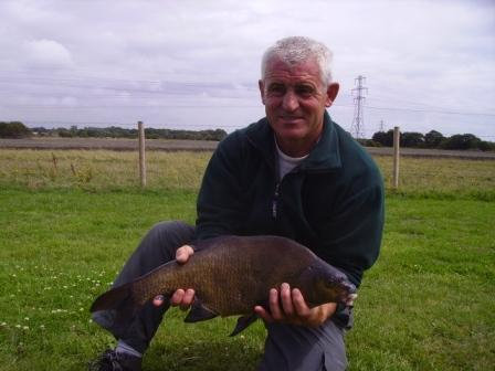 Kirk's angling companion with a nice bream