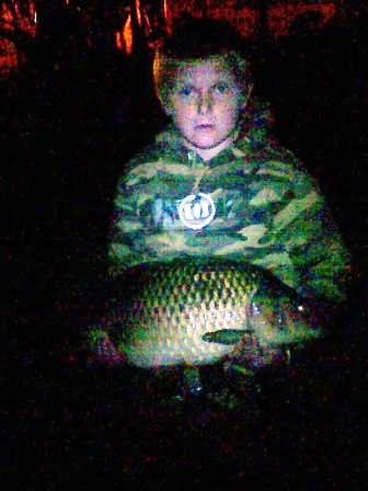 Liam Fox with his pb common carp from the Royalty weighing 20lb 9oz!!