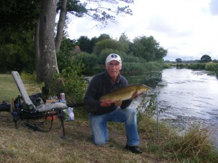 Mick Burbidge and a 10lb 6oz barbel from the Pipes