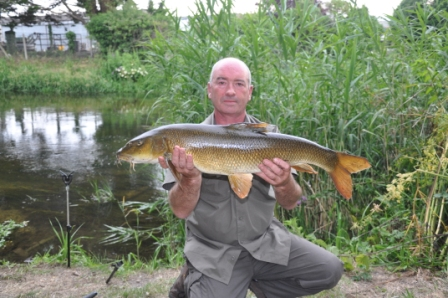 Mick-Drinkwater and his 11lb 12oz barbel from the Parlour