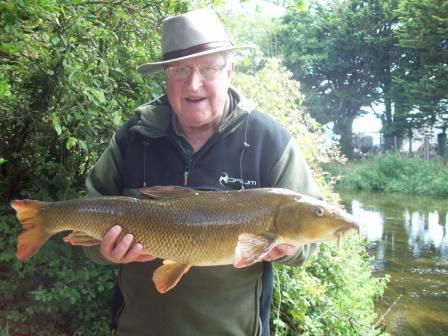 Mick Matthews with a lovely 13lb barbel from the Parlour