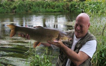 A great shot of Nick Moxey with an 11lb barbel