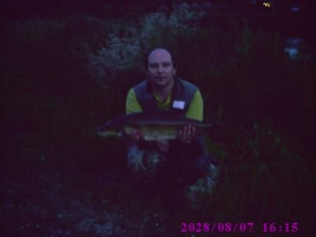Danny with yet another double figure barbel (Danny may have forgotten to use the flash on this one)