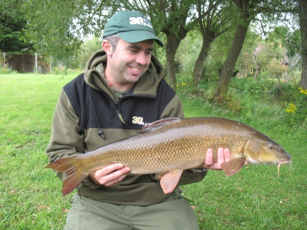 PJ with an 11lb 12oz barbel from Mugs Hole