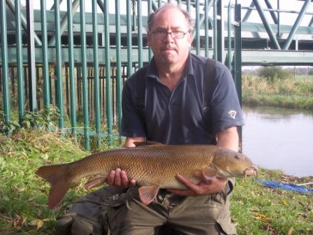 Paul Essenhigh with a lovely 14lb barbel from the Pipes landed on one of the few milder days