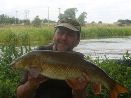 Pete Wilson with his 9lb 14oz barbel from Fiddlers