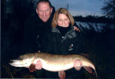 Richard and Clare pose proudly with her 22lb 9oz pike