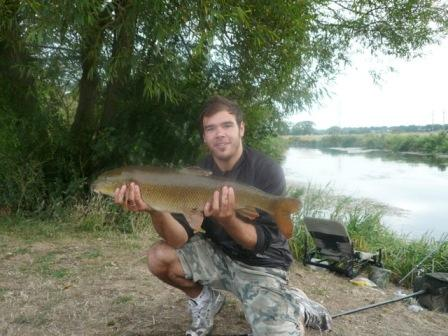 Ricky Pattenden with a lovely 12lb 8oz barbel from above the Pipes