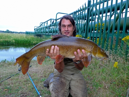 Rob Dawbarn with a classic Avon coloured 13lb barbel from the Pipes