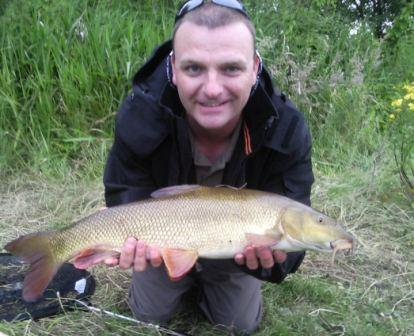 Rob Thomas with one for the future, a hard scrapping fin perfect 4lb 8oz barbel