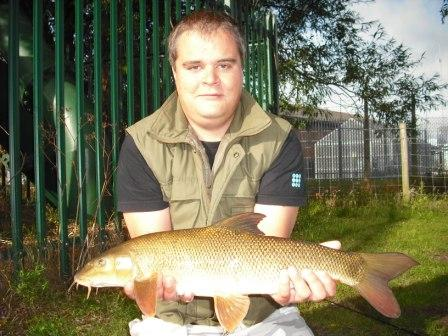 Sam Pask with his first barbel caught rolling meat at 4lb 8oz