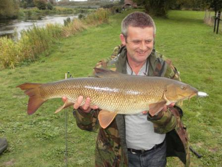 Stephen Smith looks pleased with this double figure barbel weighing 10lb 13oz