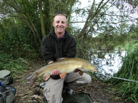 Steve Mitchell and a hard earned 12lb 2oz barbel from below Harrigans