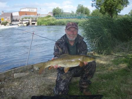 Tony Deakin with his first ever barbel at 7lb 8oz